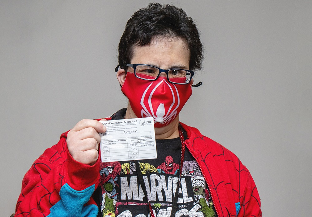 STC Member Catherine Spero proudly displays her vaccination card