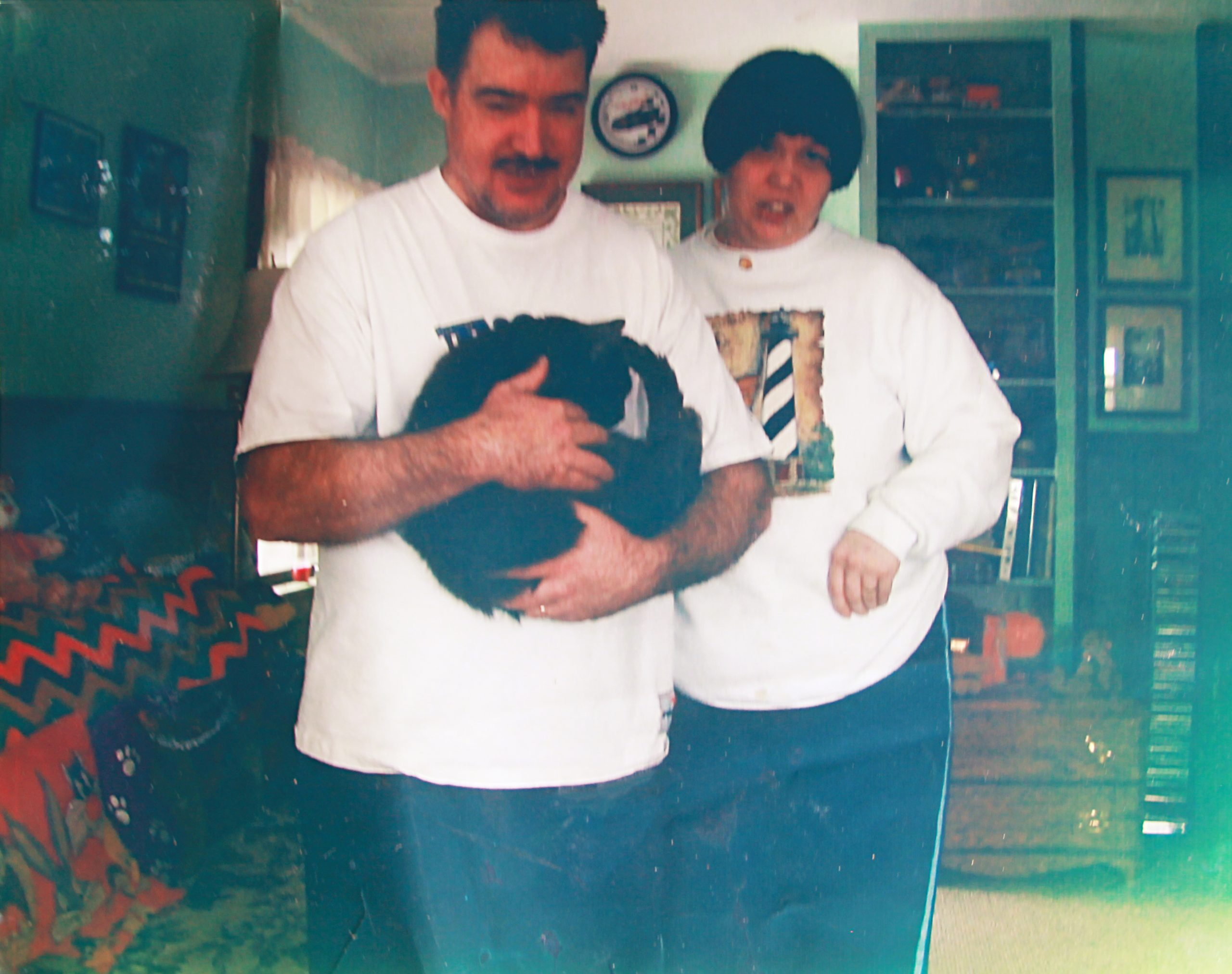 Janet and Chris in their first apartment with their cat, Levi