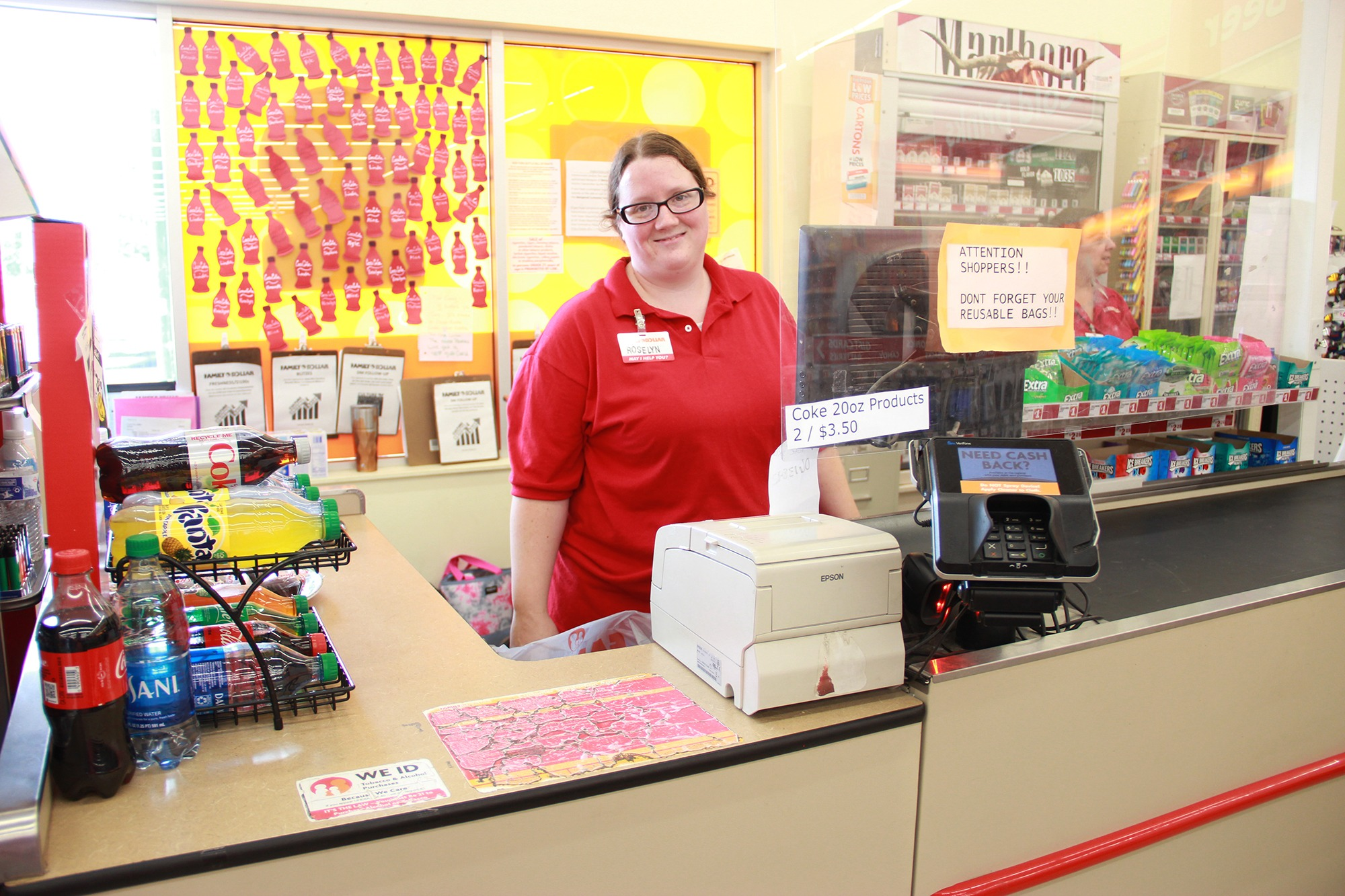 Roselyn Hathaway stands behind the front counter at her job at the Dollar General in Sidney
